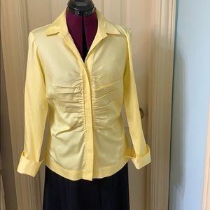 Yellow shirt with turned up cuffs.